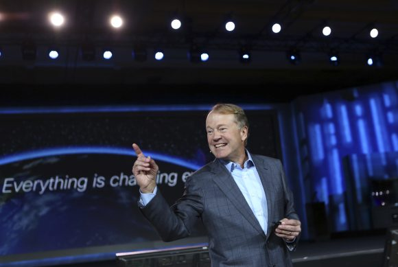 Cisco CEO John Chambers gestures to the audience during his keynote speech at the annual Consumer Electronics Show (CES) in Las Vegas